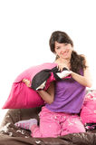 Pretty young girl wearing pajamas having a pillow Royalty Free Stock Image