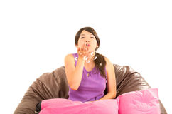 Pretty young girl wearing pajamas sitting with Royalty Free Stock Images