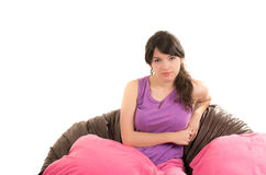 Pretty young girl wearing pajamas sitting with Royalty Free Stock Photo
