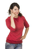 Pretty young girl wearing red top gesturing call. Me phone with hand isolated on white Royalty Free Stock Photography