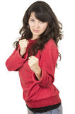 Pretty young girl wearing red top posing with Royalty Free Stock Photo