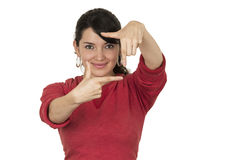 Pretty young girl wearing red top posing making Royalty Free Stock Photos