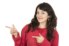Pretty young girl wearing red top posing pointing Stock Image