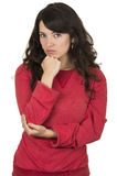Pretty young girl wearing red top posing serious Stock Images