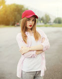 Pretty young girl wearing a shirt and red cap Stock Photography