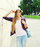 Pretty young girl wearing a summer straw hat outdoors Stock Images