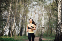 Pretty young girl weat in training clothes running in the park stock photos