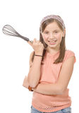 Pretty young girl with a whisk for cooking Stock Images