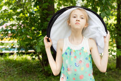 Pretty Young Girl in White Round Hat Outdoor Royalty Free Stock Image