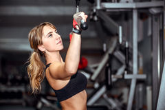 Pretty young girl workout in the gym Stock Images