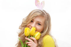 Pretty young girl with yellow tulips Royalty Free Stock Photography