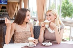 Pretty young girls are relaxing in restaurant Royalty Free Stock Image