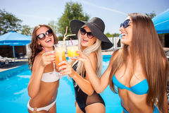 Pretty young girls are resting on vacation Stock Images