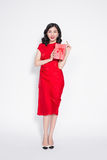 Pretty young glamorous asian woman dressed in red dress with a p Stock Image