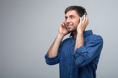 Pretty young guy is listening to music Stock Photos