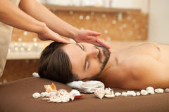 Pretty young guy is relaxing at spa Stock Photography
