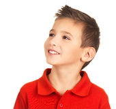 Pretty young happy boy looking away. Photo of pretty young happy boy looking away over white background Royalty Free Stock Photos