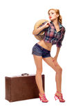 Pretty young happy woman with travel bag and hat. Waiting Royalty Free Stock Photos