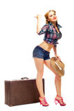 Pretty young happy woman with travel bag and hat. 