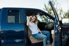 Blonde teenager receives a car as present royalty free stock image