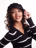 Pretty young hispanic woman with hand to hat. Young woman with big smile and hat Stock Photography