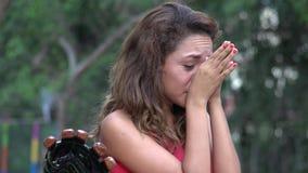 Tearful Hispanic Woman Crying. A pretty young hispanic woman stock footage