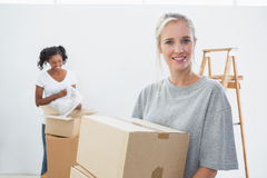 Pretty young housemates moving into new home Stock Photo