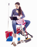 Pretty young housewife consult your laptop in a break Royalty Free Stock Photo