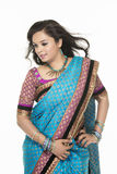 Petty young Indian girl in saree Royalty Free Stock Images