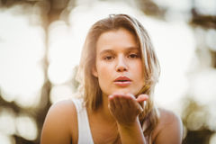 Pretty young jogger blowing kiss Royalty Free Stock Photo