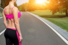 Pretty young jogger resting after training Royalty Free Stock Photos
