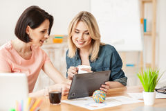 Pretty young ladies are using technology for fun Royalty Free Stock Photography