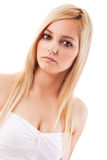 Pretty Young Lady. Portrait of a beautiful blonde young woman, looking serious. Studio shot, isolated on white background royalty free stock photography