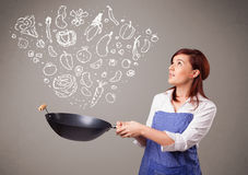 Young woman cooking vegetables Stock Image