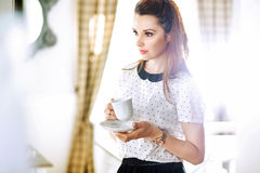 Pretty young lady drinking coffee Royalty Free Stock Photo