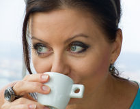 Pretty young lady drinking coffee. In Zizkov tower in Prague Royalty Free Stock Photography