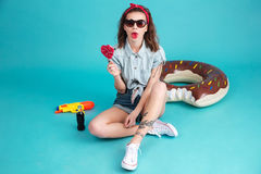 Pretty young lady eating candy. Royalty Free Stock Photos