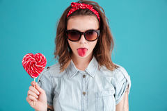 Pretty young lady eating candy. Stock Image
