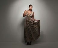 Pretty young lady in a elegant evening dress Royalty Free Stock Image