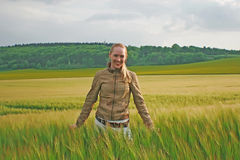 Pretty young lady in green wheat field Royalty Free Stock Image