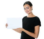 Pretty young lady holding a blank billboard stock images