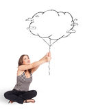 Young lady holding cloud balloon drawing Royalty Free Stock Image