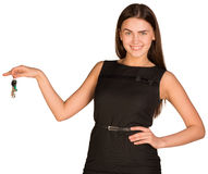 Pretty young lady holding keys Royalty Free Stock Images
