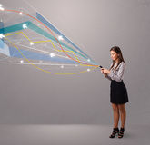 Pretty young lady holding a phone with colorful abstract lines a Royalty Free Stock Images