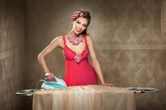 Pretty young lady ironing Stock Photos