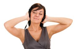 Pretty young lady listening to music Royalty Free Stock Photo