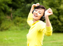 Pretty young lady listening to music Stock Photo