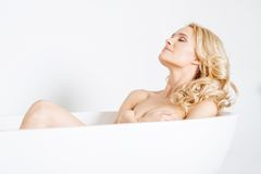 Pretty Young Lady Naked on White Bathtub Royalty Free Stock Photography