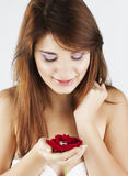 Pretty young lady with red rose. Beautiful young girl with a red rose and a ring on a white background royalty free stock photo