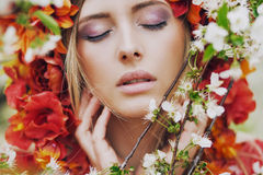 Pretty young lady relaxing in the fragrant garden Stock Photo